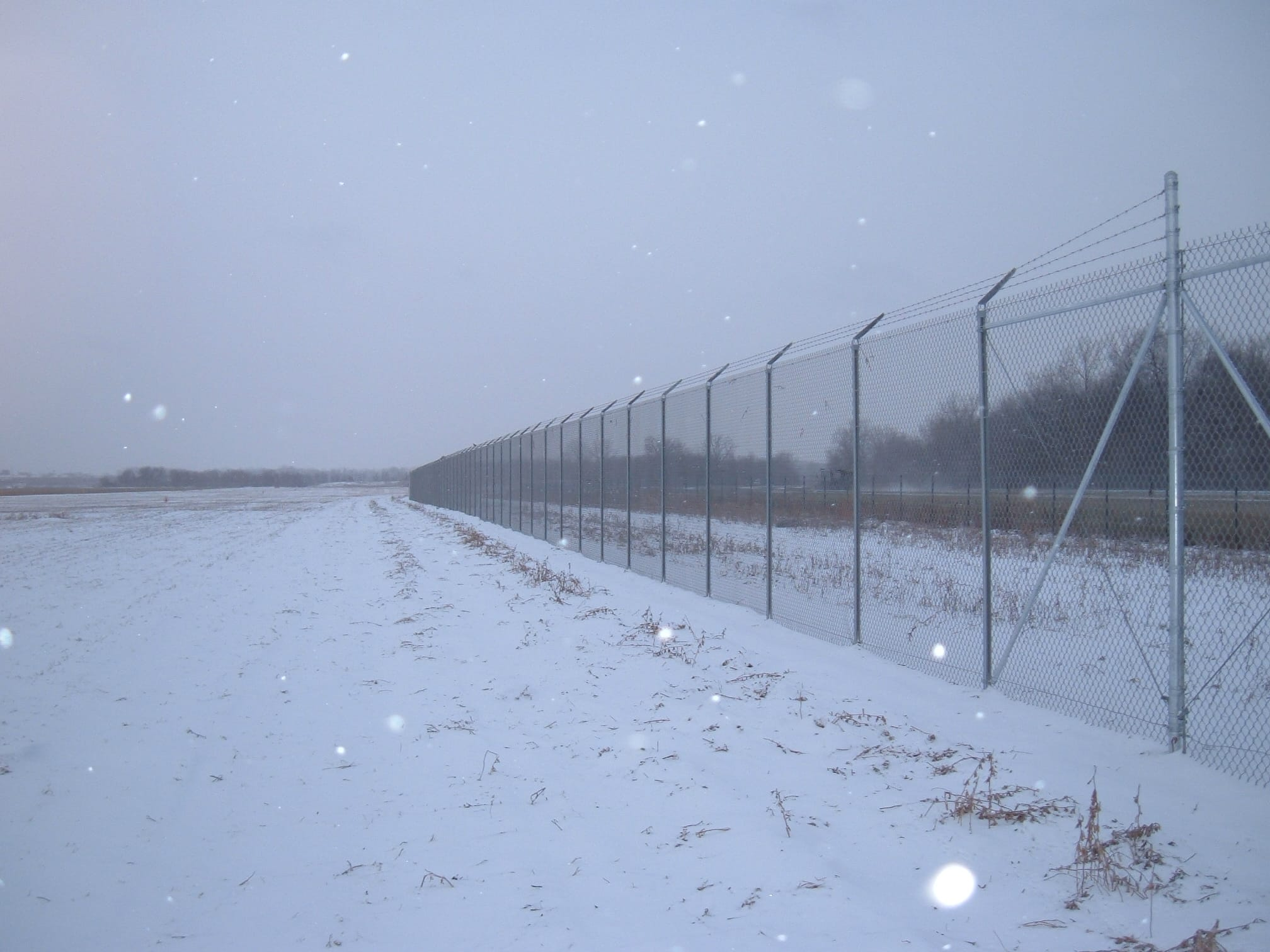 Image of commercial chain link security fencing at Willow Run Airport