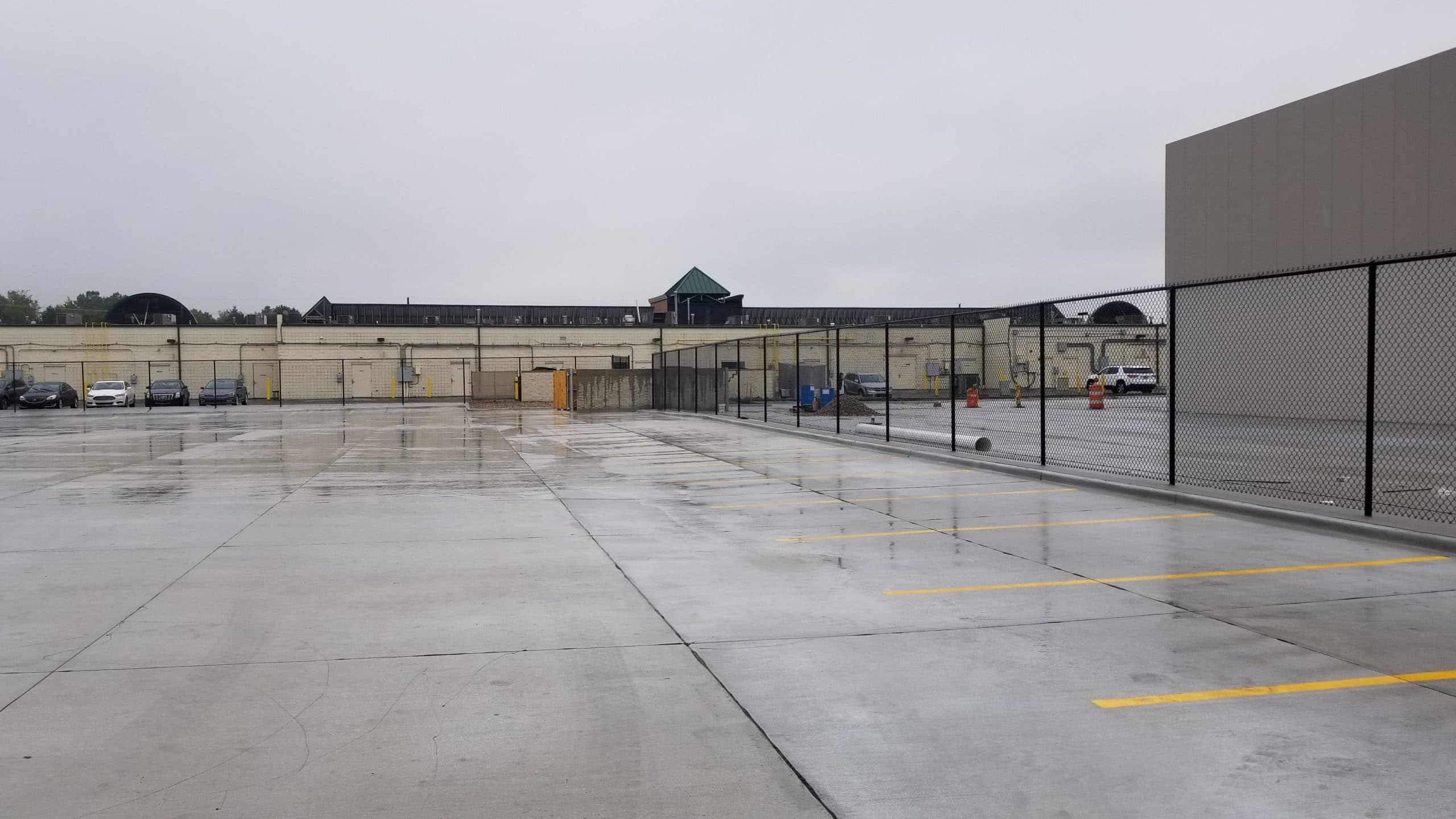 Image of commercial chain link fencing and gates at the Van der Graaf