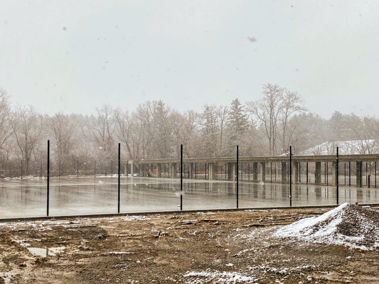 Image of new commercial tennis courts with chain link fencing and posts at Cranbrook Schools