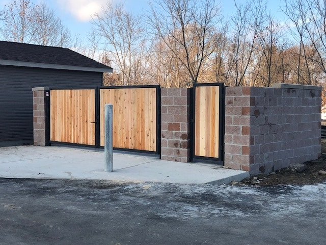 Image of commercial wood and steel dumpster gates at Norman Towers Senior Apartments