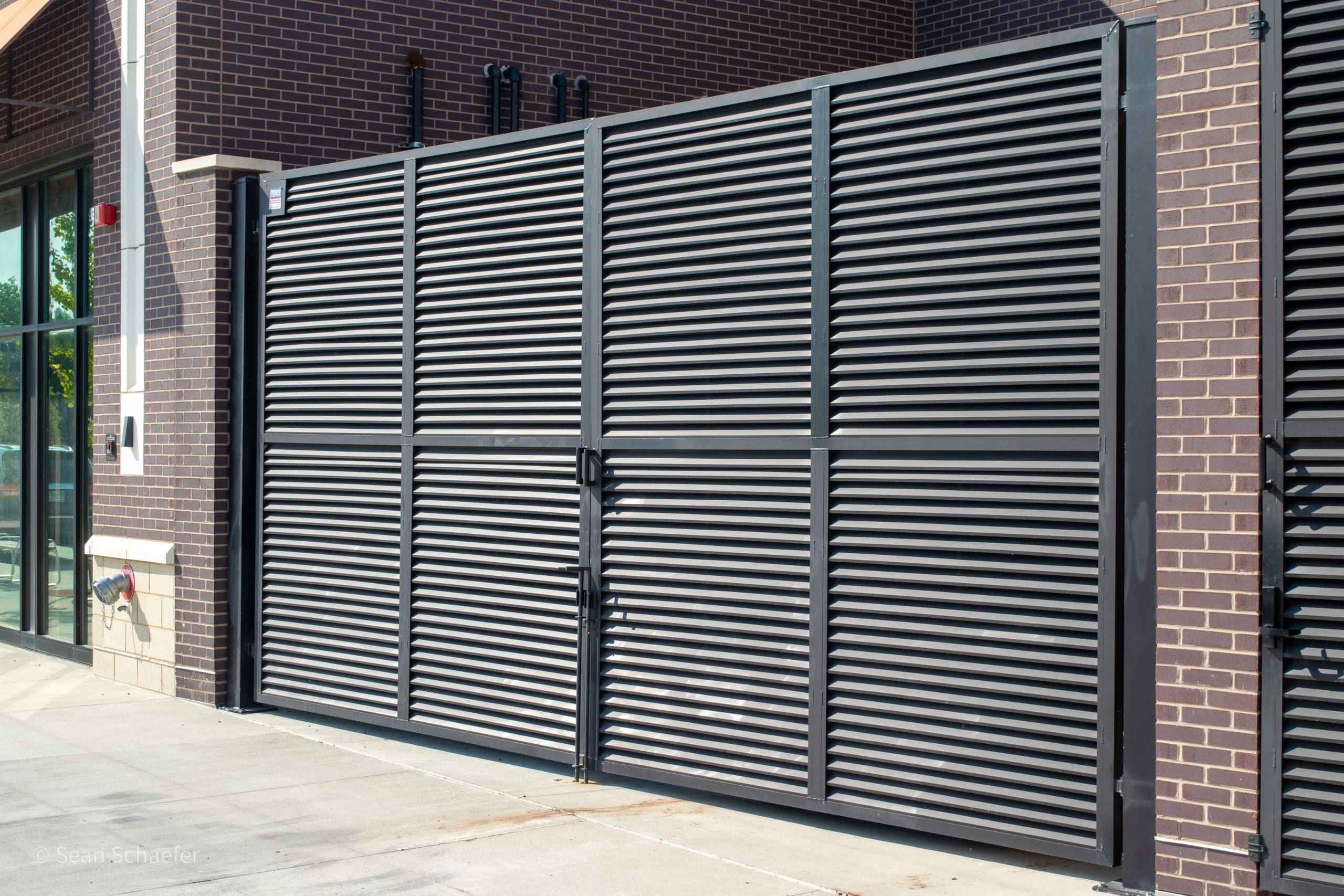 Image of commercial AmeriLouver® dumpster gates at Woodward Corners by Beaumont