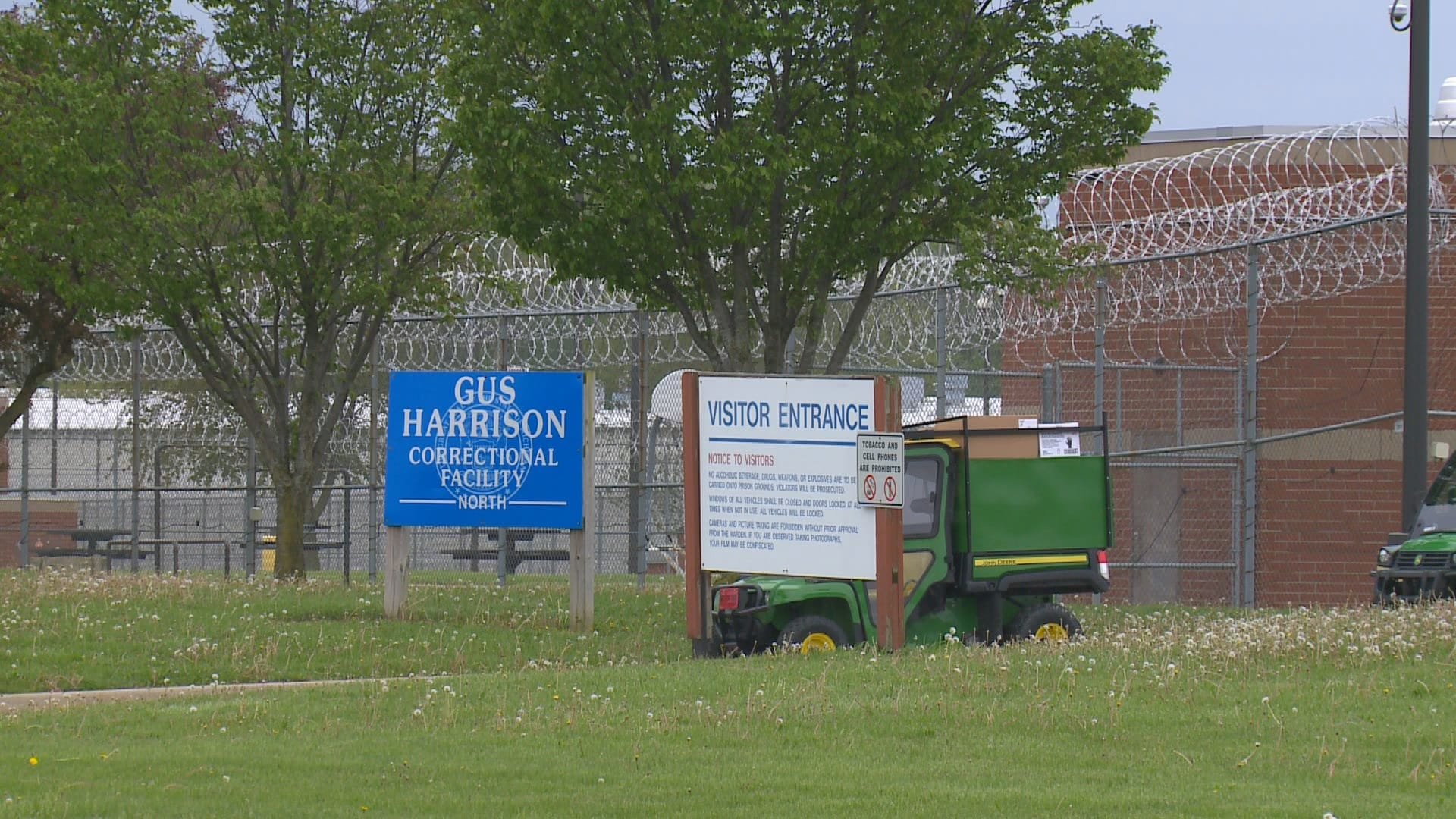Image of commercial chain link fencing, barbed wire, and security lighting at Gus Harrison Correctional Facility