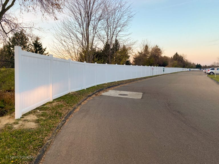 Image of commercial PVC privacy fencing at Bethany Villa Apartments