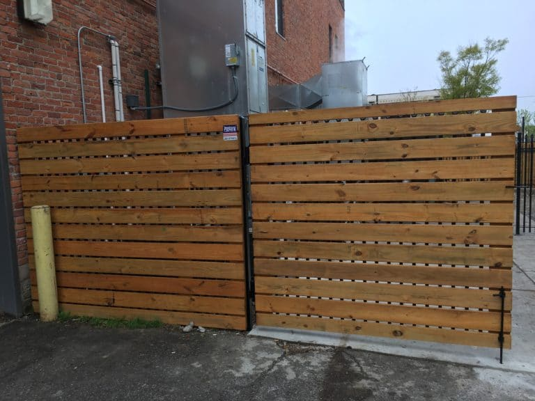 Image of commercial wood and steel dumpster enclosure and gates at Elton Park Corktown