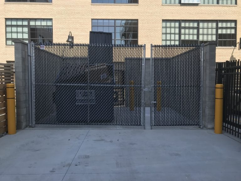 Image of commercial chain link fencing and swing dumpster gates at Elton Park Corktown in Metro Detroit, Michigan
