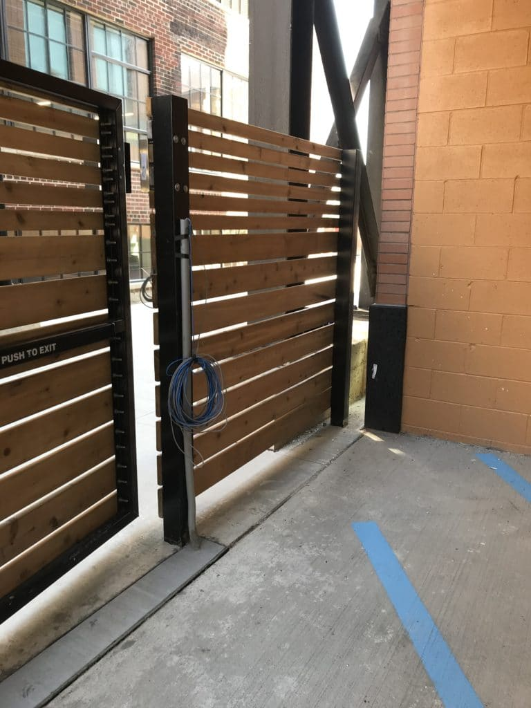 Image of commercial wood privacy fencing and swing gates at Elton Park Corktown in Metro Detroit, Michigan