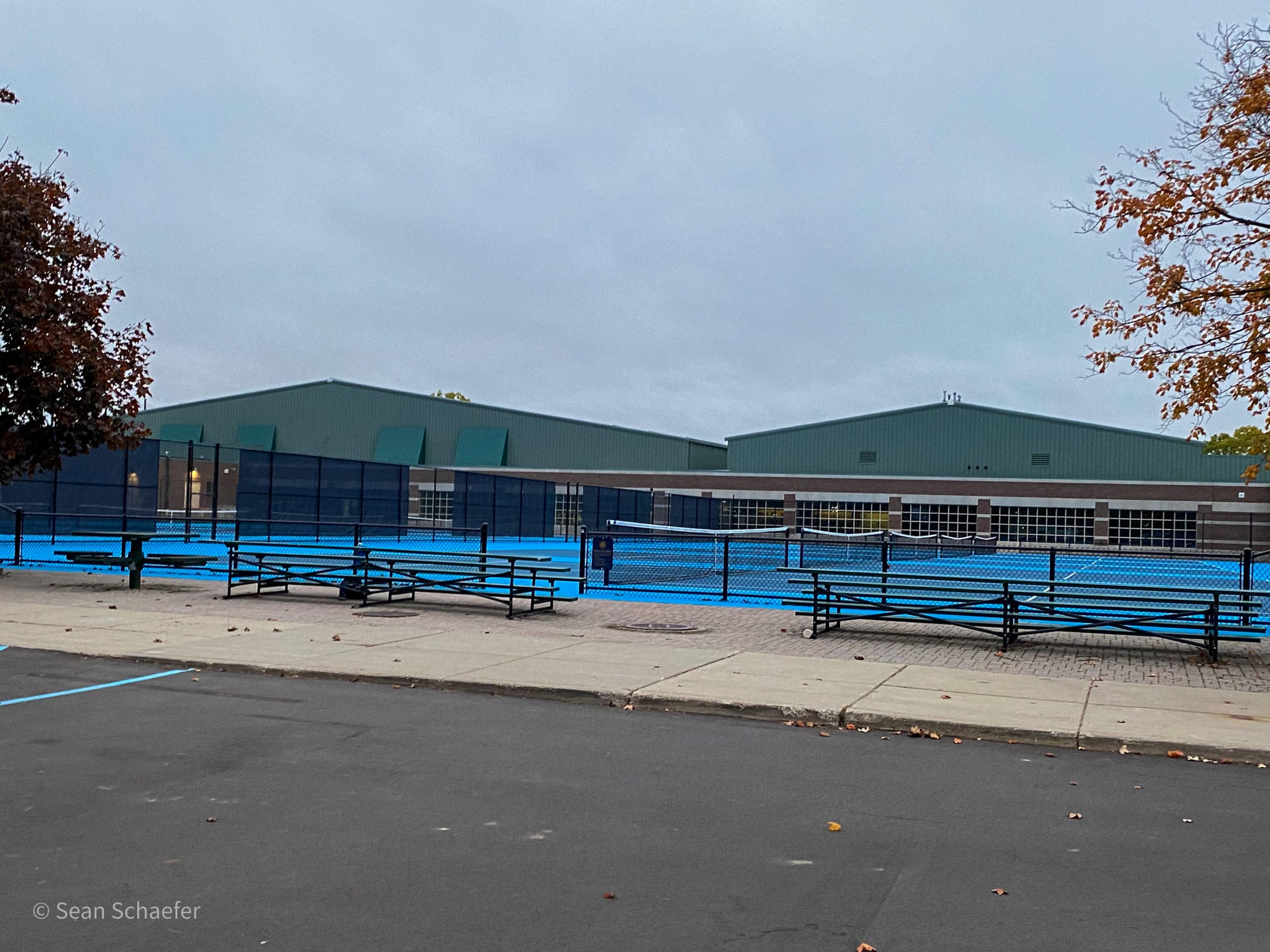 Image of commercial tennis courts with chain link fencing and posts at Detroit Country Day School