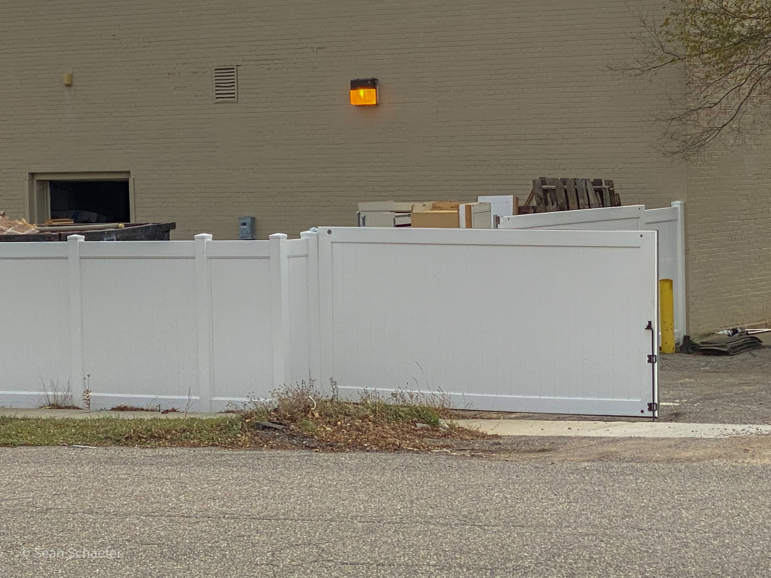 Image of PVC / vinyl commercial dumpster enclosure and gates at Habitat for Humanity ReStore