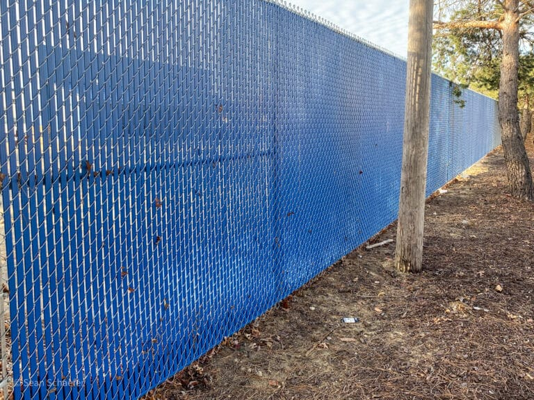 Image of commercial chain link fence with PVC privacy slats in Metro Detroit, Michigan