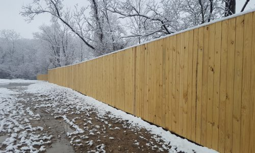 Background image of commercial wood privacy fencing in Metro Detroit, Michigan
